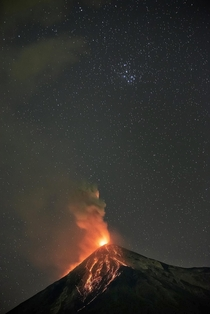 Las Pleiades and the Fuego volcano in Guatemala