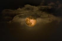 Last nights moon from Norway A bit cloudy but I though it looked huge on the night sky Used my Nikon d with a tamron -mm lens One shot at s shooting the clouds and one at  for the moon then prosessed in photoshop Hope you enjoy my work