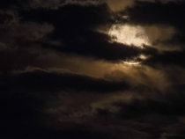 Last nights Moon through the haze and clouds