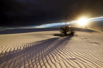 Late day sun peaking between the clouds in White Sands NM