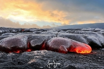 Lava flowing from Kilauea volcano Hawaii  by James Binder