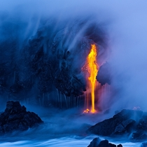 Lava flows into the ocean on the Big Island Hawaii  photo by Miles Morgan