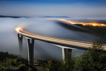 Layers of low cloudiness rolling over viaduct rni Kal Slovenia  Author Marko Koroec
