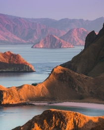 Layers of sunrise across various islands in Komodo National Park Indonesia