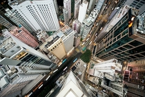 Leaning over a rooftop in Hong Kong