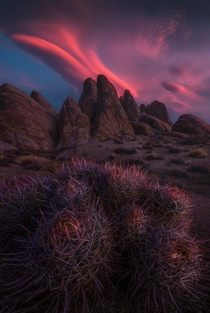 Lenticular clouds at sunrise over the granite formations of Californias Alabama Hills
