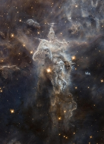 Less colorful but equally stunning view of one of the pillars of creation deep inside Messier  Eagle Nebula  light-years from earth This pillar is roughly  light-years tall Hubble
