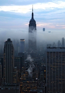 Light fog around the Empire State Building New York City