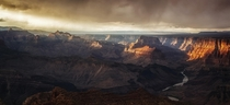 Light piercing the clouds to shine on the glorious Grand Canyon Arizona  photo by Danilo Faria