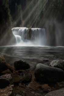 Light rays shining on a waterfall in the Gifford Pinchot National Forest in Washington