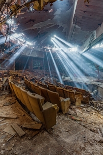 Light shining into an abandoned theater