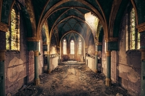 Light streams into an abandoned church  By Leon Beu