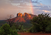 Lightning and a rainbow gracing Cathedral Rock in Sedona Arizona  photo by Guy Schmickle