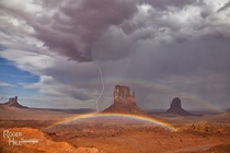 Lightning and rainbows in Monument Valley Photo by Roger Hill