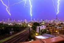 Lightning on the Chicago skyline with a great rail line shot x-post from rpics