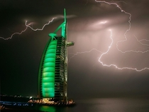 Lightning strikes above the sail-shaped Burj Al Arab hotel Dubai UAE Architect Tom Wright photo by Maxim Shatrov