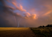 Lightning strikes and rainbow North Dakota