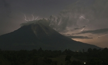 Lightning strikes as Mount Sinabung volcano spews ash and lava at Simpang Empat village Indonesias North Sumatra province on September