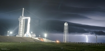 Lightning strikes in the distance with SpaceX Crew Dragon Demo  on pad A