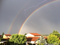 Lightning stuck between two rainbows Lyon France