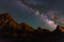 Like a Galactic volcano the Milky Way over the Watchmen Zion National Park Utah