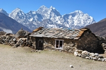 Like a scene out of Lord of the Rings an abandoned shack on the Great Himalayan Trail Nepal