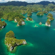 Limestone islets of Kabui Bay Indonesia  x