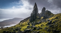 Little man looking at the Old Man of Storr Isle of Skye