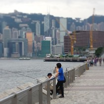 Locals fishing with the Hong Kong skyline in the background x