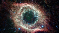 Located about  light-years from Earth the eye-like Helix nebula is a planetary nebula or the remains of a Sun-like star Credit NASAJPL-Caltech