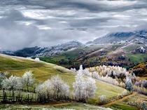Lofty Frost over the village of Petera RomaniaPhotograph by Eduard Gutescu