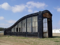 London subway entrance sitting in a field in texas