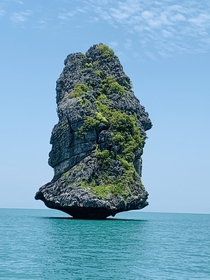 Lone rock in the sea Anthong Islands National Marine Park