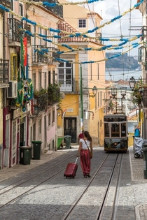 Lone Traveler Lisbon  Portugal by Brad Hammonds