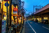 Lonely Street in Kobe Japan by Alberto Sanchez