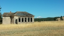 Long abandoned school with Mt Adams in the background Goldendale WA