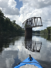 Long-abandoned swing bridge on the Suwannee river Points to the tree for growing out of all that rusted metal Photo by Walker McKnight