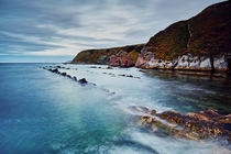 Long exposure of Cove Harbour at dusk Cove Harbour Scottish Borders Scotland