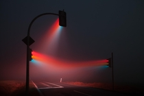 Long exposure of traffic signals apparently in fog