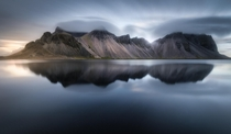 Long exposure of Vestrahorn the sea and some amazing lenticular clouds  tristantodd