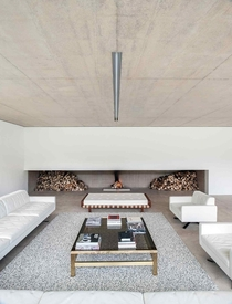 Long Fireplace in Minimal Residence - by Found Associates