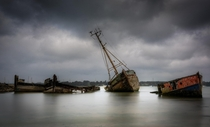 Long-forgotten Ships in the River Orwell at Pin Mill Suffolk UK  by Richard Sherman