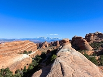 Long ridges of slick sandstone and other amazing rock formations in Devils Garden Arches National Park Utah