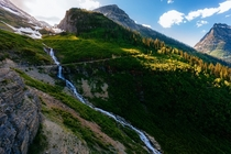 Long trickling waterfall through Logan Pass Glacier National Park MT