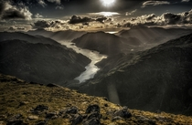 Looking across Loch Hourn into the wilderness of Knoydart from the summit of Sgurr aMhaoraich Beag at sunset Scotland  by Graham Bradshaw