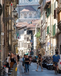 Looking down an alley at il Duomo in Florence Italy