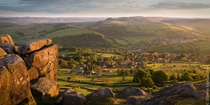 Looking down to the village of Curbar from Curbar Edge in the Peak District England