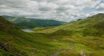Looking down towards Easedale Tarn and Grassmere Lake District UK