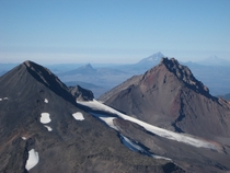 Looking north view from summit of South Sister Oregon and rest of Cascade range  by John Emmons