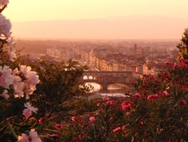 Looking out from the Piazzale Michelangelo as the sun sets over Florence Italy